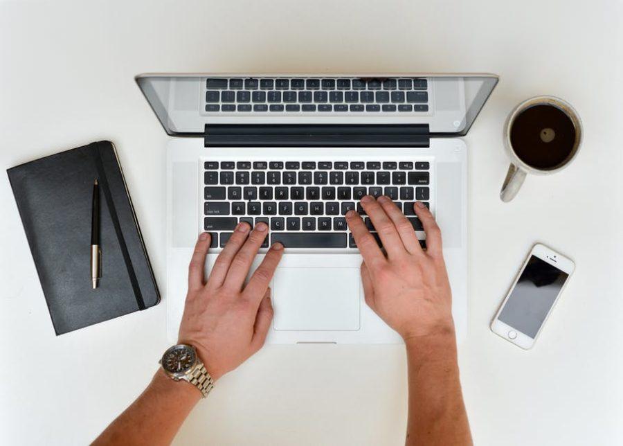 laptop writing coffee pen